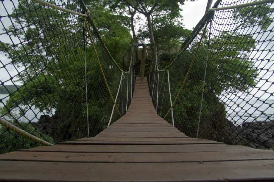 A suspension bridge connects the Cala Mia property in Panama to its spa located a top a rocky island. Photo: Tom Gandy