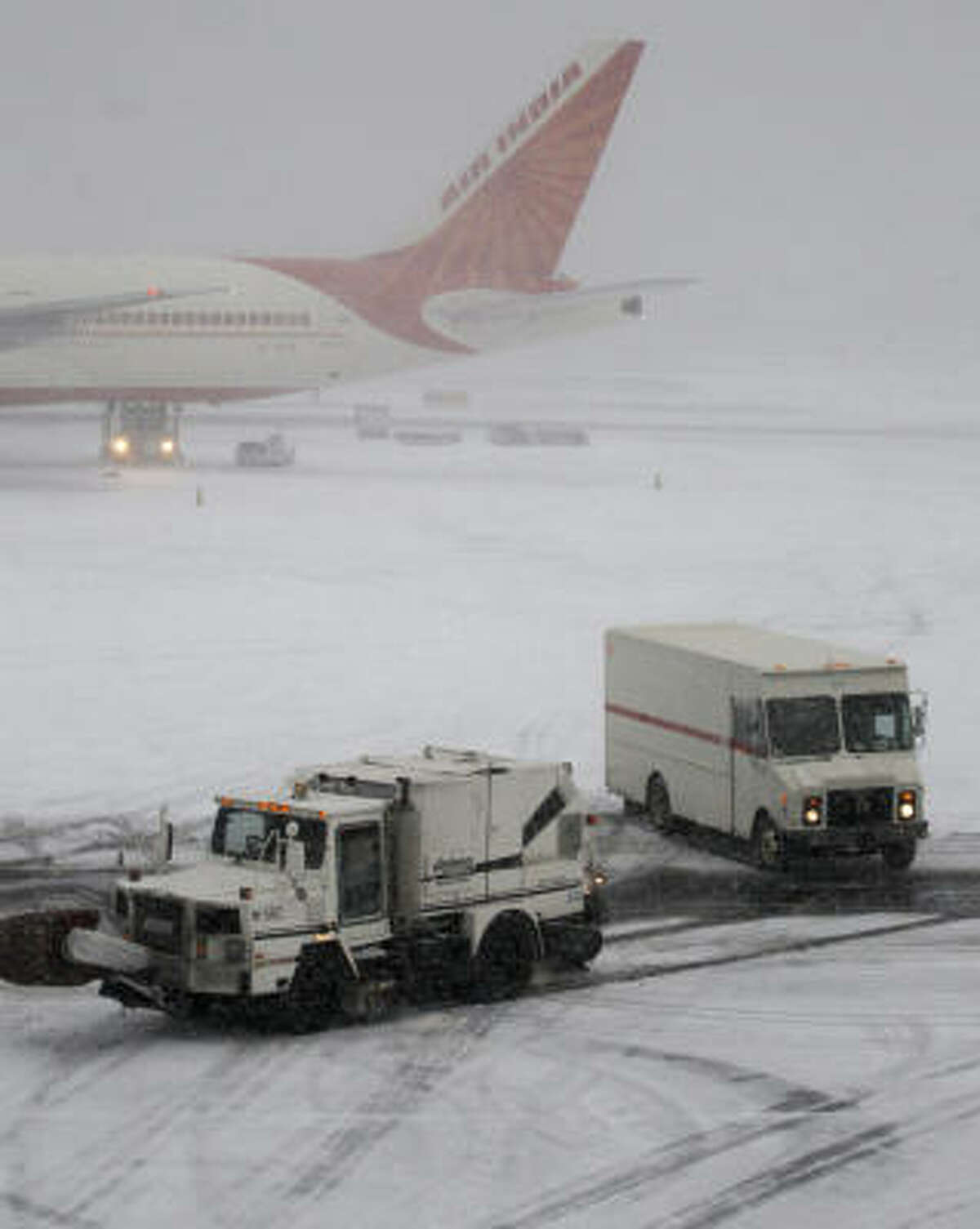An Air India plane is seen at Newark Liberty International Airport during Sunday's snow storm.