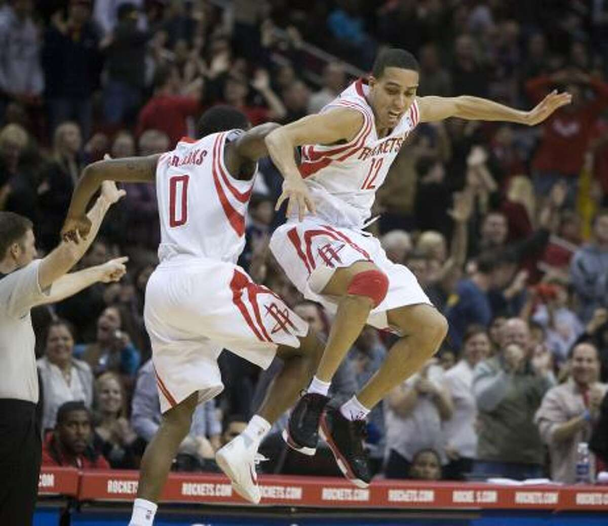 Rockets shooting guard Kevin Martin (12) and point guard Aaron Brooks (0) celebrate Martin's 3-point shot.