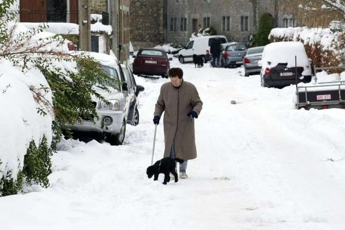 Walking along a snow-covered street in Esneux, Belgium, on Dec. 27.