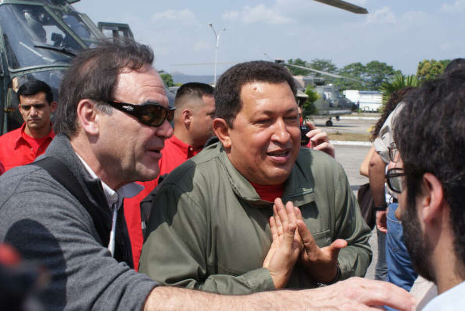 Director Oliver Stone, left, and Venezuelan President Hugo Chávez meet with members of the media during the filming of South of the Border. Photo: José Ibañez