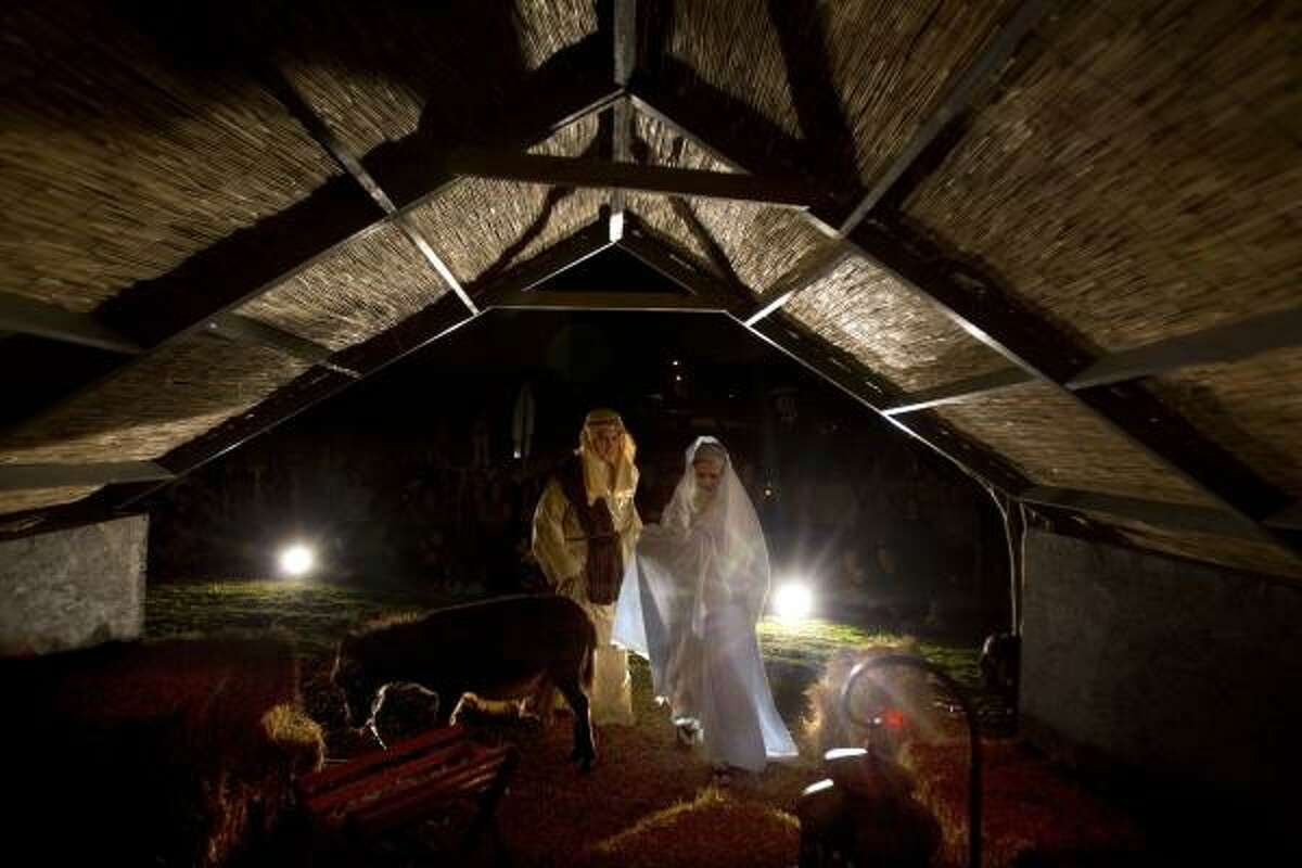 Michael Barrett, his wife Bevin and their eight-month-old daughter, Alyssa, played the rolls of Mary, Joseph and baby Jesus, as Mary and Joseph made their way to the inn during a living nativity scene at St. Luke's Presbyterian Church Wednesday, Dec. 15, 2010, in Houston.
