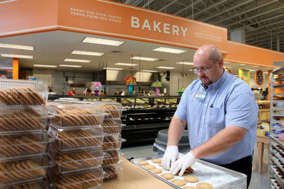 FROM THE OVEN: David Holley a bakery merchandiser, boxes freshly baked cookies to sell at the H-E-B Katy Market, 25675 Nelson Way in Katy, which opened Aug. 4. Photo: Suzanne Rehak, For The Chronicle
