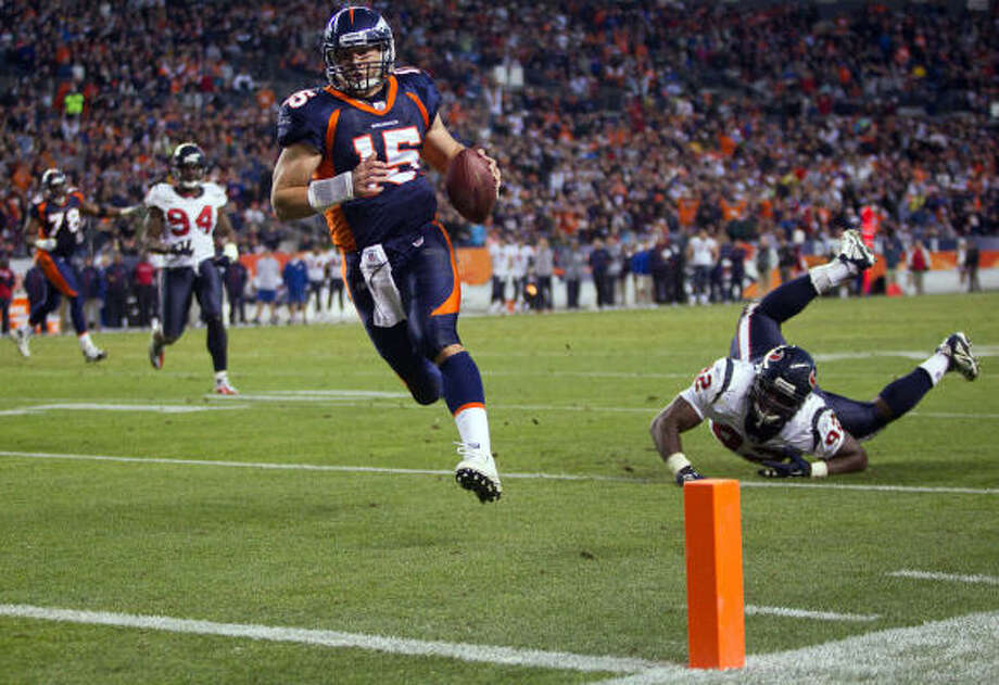Dec. 26: Broncos 24, Texans 23Broncos quarterback Tim Tebow (15) races past Texans defensive tackle Earl Mitchell on a 6-yard touchdown run that gave Denver a 24-23 lead with 3:11 remaining. The Broncos held on from there to win Sunday in Denver. Photo: Smiley N. Pool, Chronicle