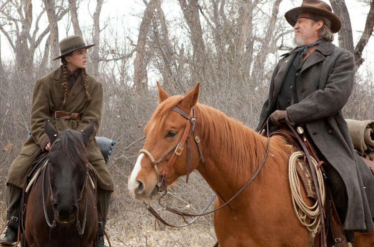 True Grit , $25.6 million: A young girl hires a drunken gunfighter to help her avenge her father's death. Hailee Steinfeld and Jeff Bridges star in the remake of the John Wayne film.