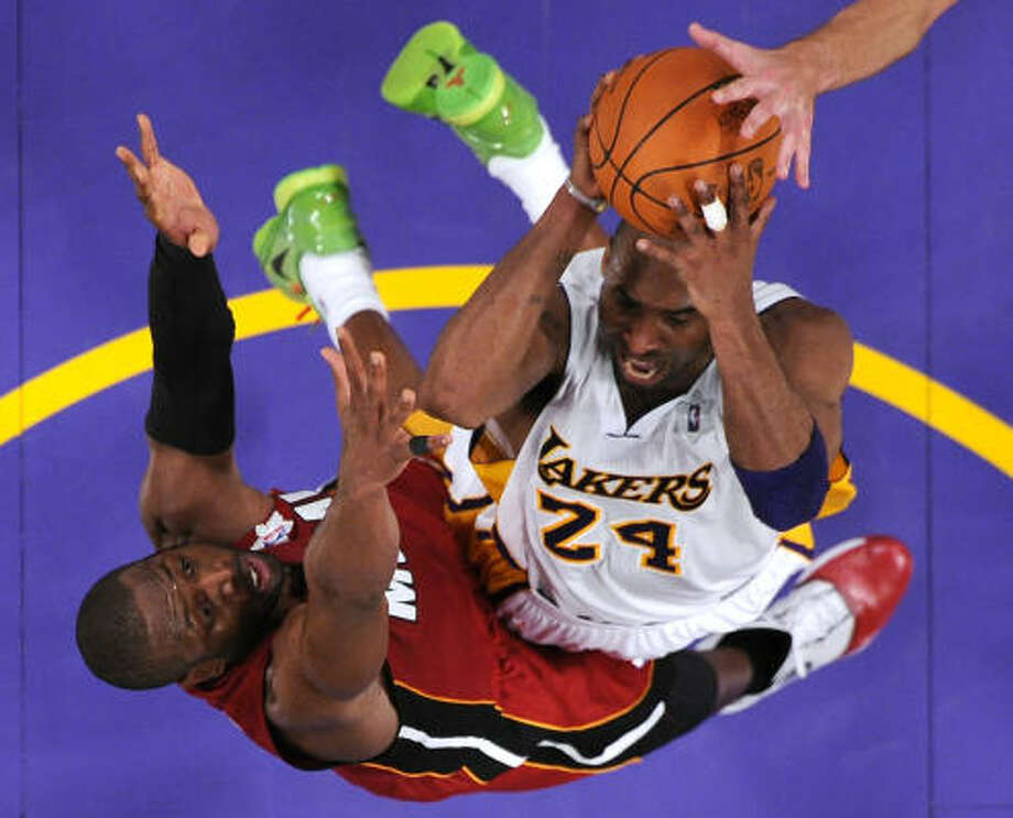 Heat 96, Lakers 80 Lakers guard Kobe Bryant (24) struggled in Saturday's game against the Heat, scoring just 17 points on 6-of-16 shooting. Photo: Mark J. Terrill, AP