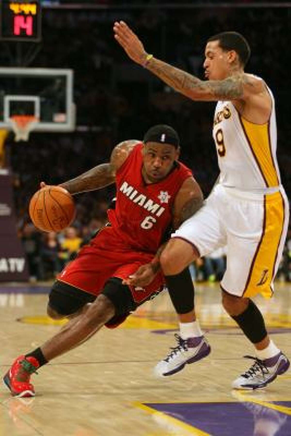 Heat forward LeBron James (6) recorded a triple-double with 27 points, 11 rebounds and 10 assists.