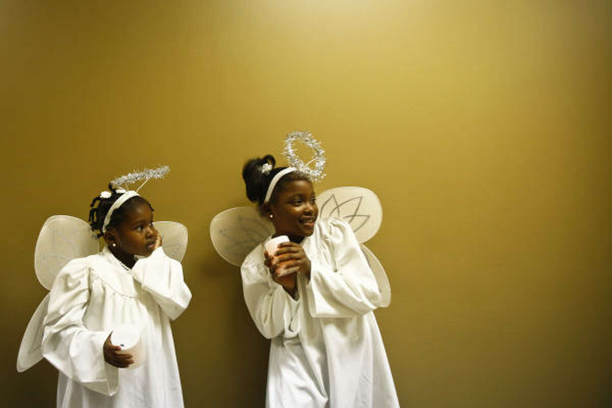 Ayana, left, and Briana can't seem to hold their excitement.