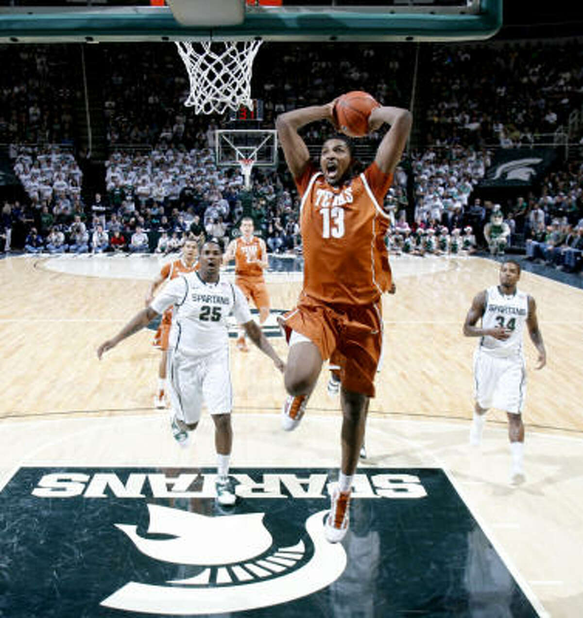 Dec. 22: Texas 67, Michigan State 55 Texas' Tristan Thompson scores on a breakaway dunk in the first half of Wednesday night's game against Michigan State in East Lansing, Mich. Thompson had 17 points and 15 rebounds in the Longhorns' win.
