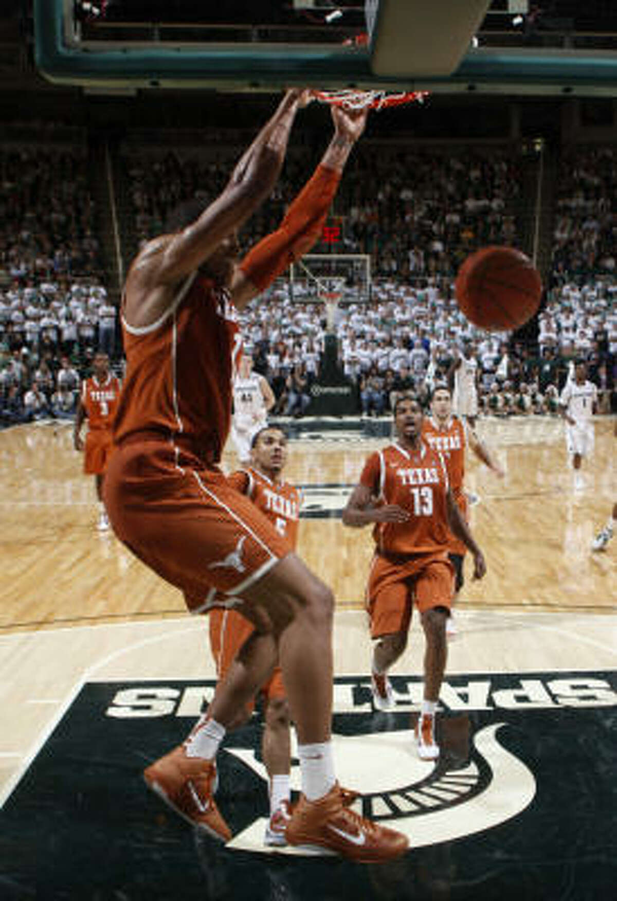Texas' Gary Johnson throws down a dunk during the second half.