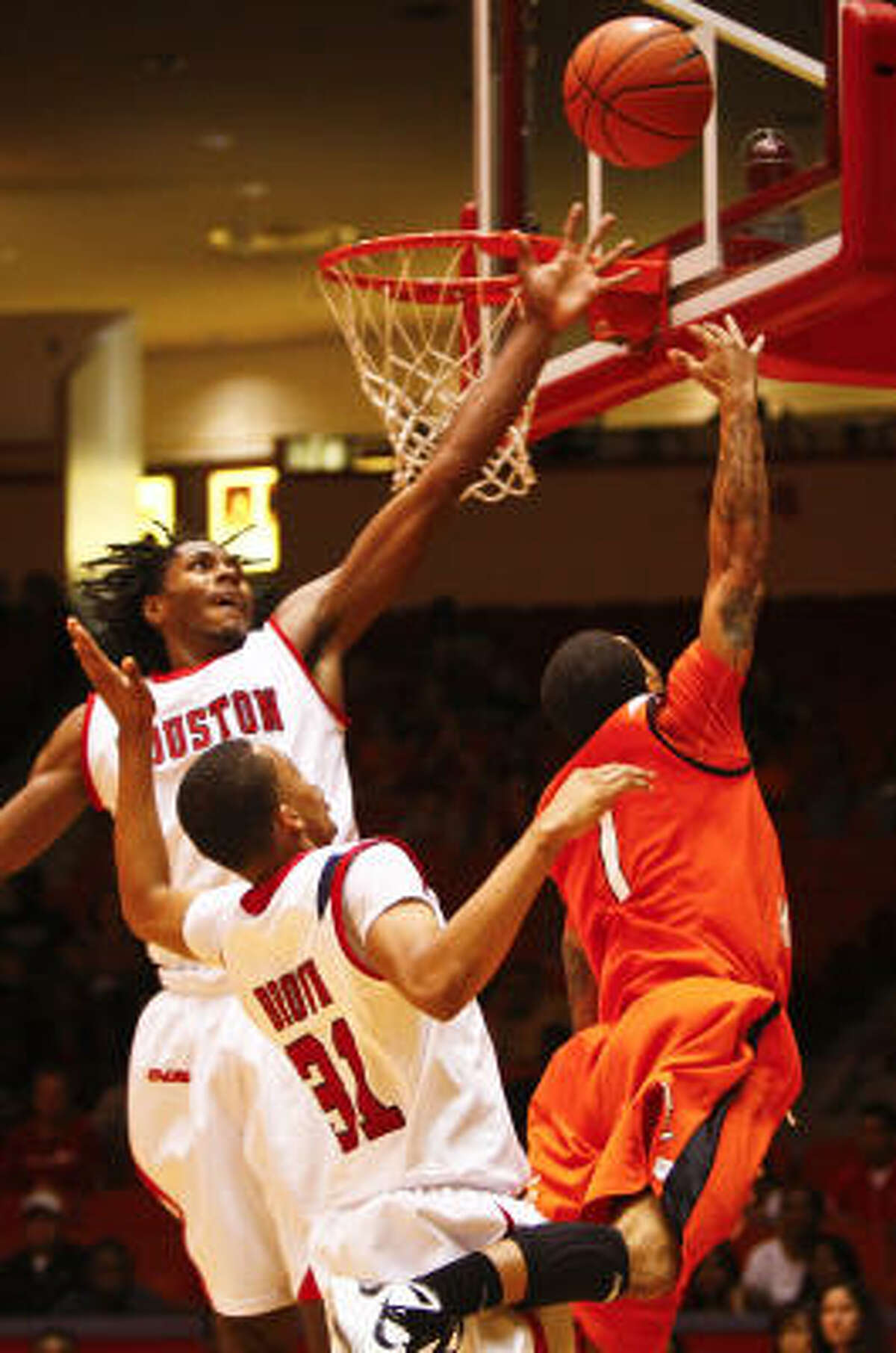 Houston's Maurice McNeil (3) recorded 18 points and nine rebounds.