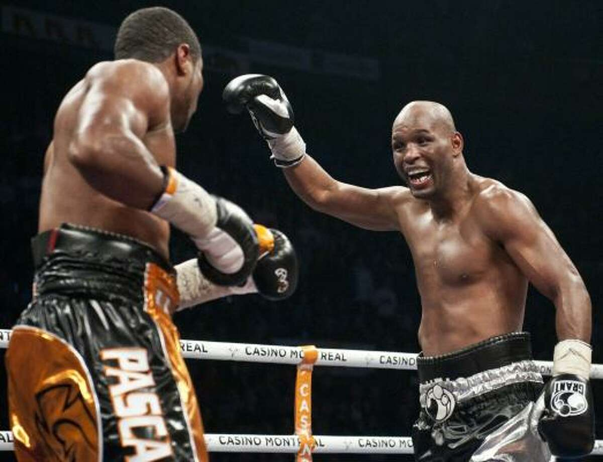 Bernard Hopkins, right, taunts Jean Pascal during the WBC Light Heavyweight World Championship fight at the Pepsi Coliseum in Quebec City.