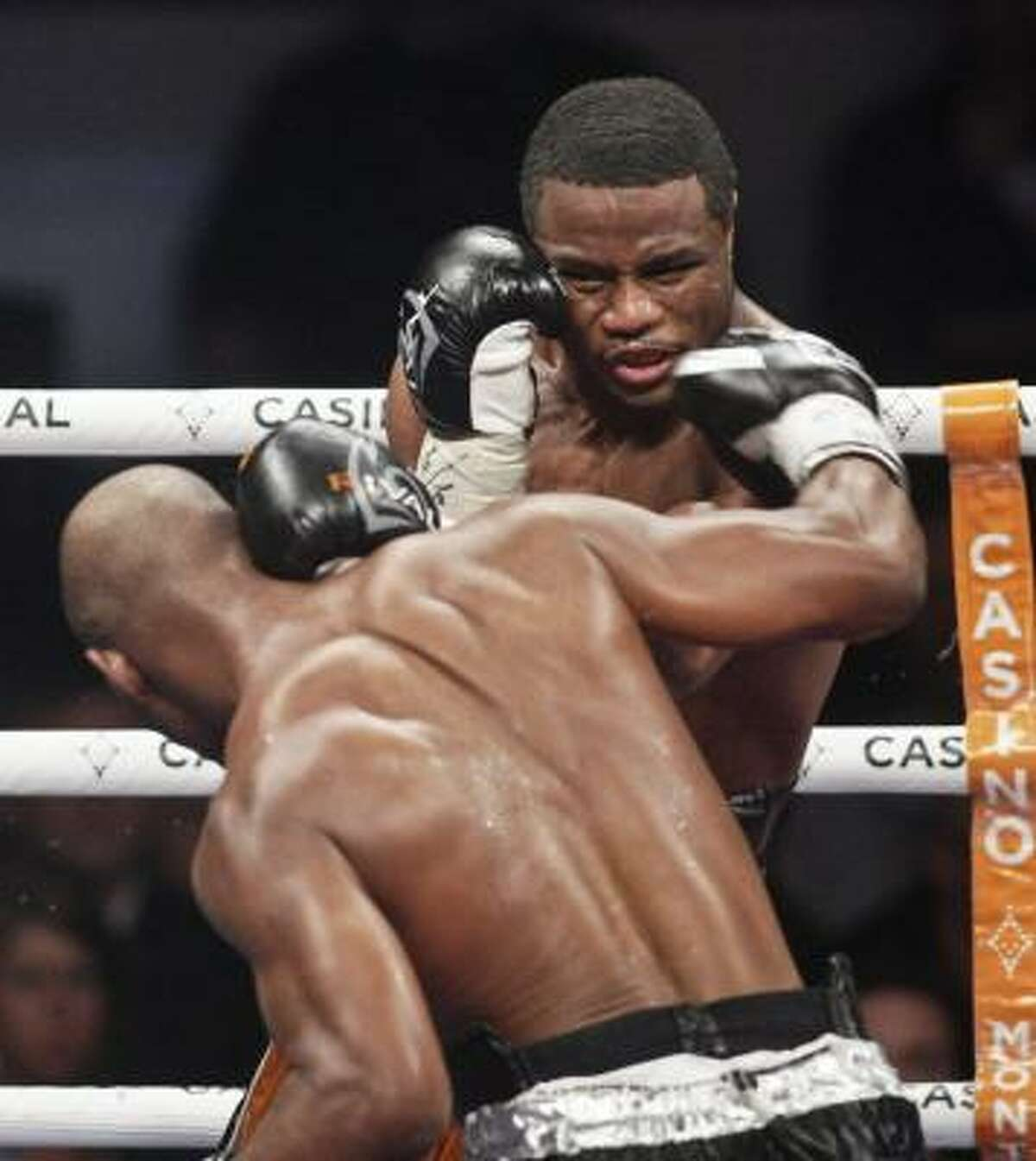 Bernard Hopkins lands a right on WBC light heavyweight champion Jean Pascal.