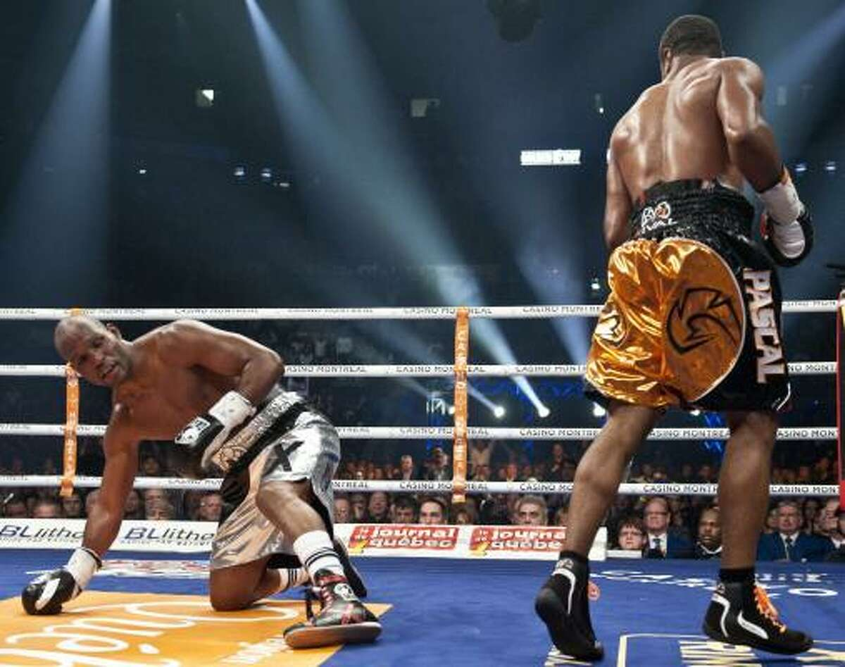 Jean Pascal puts Bernard Hopkins on the floor with a punch in the third round.