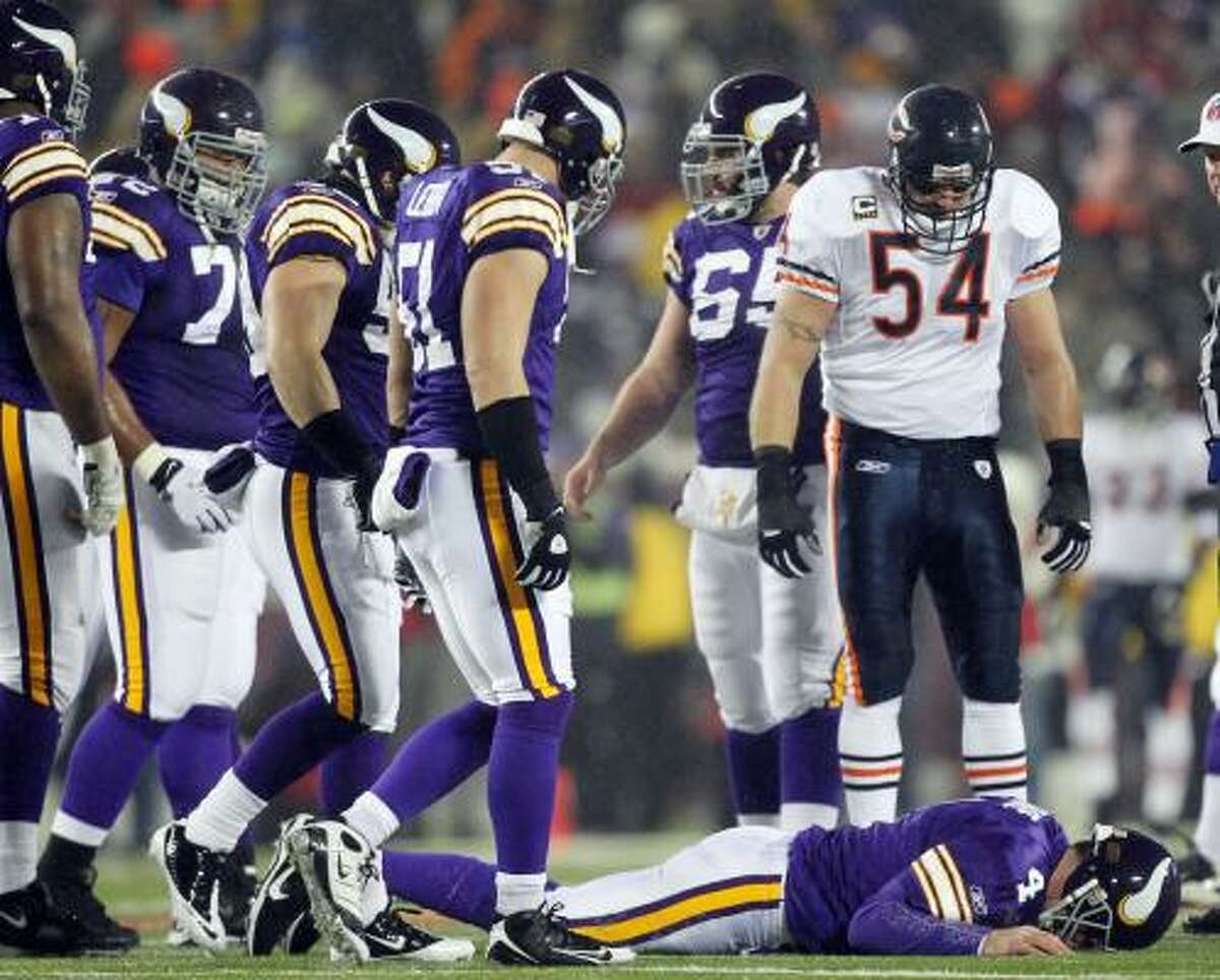 Dec. 20: Bears 40, Vikings 14 Chicago Bears linebacker Brian Urlacher looks down as Minnesota Vikings quarterback Brett Favre lies on the ground after being hit during the first half on Monday night.