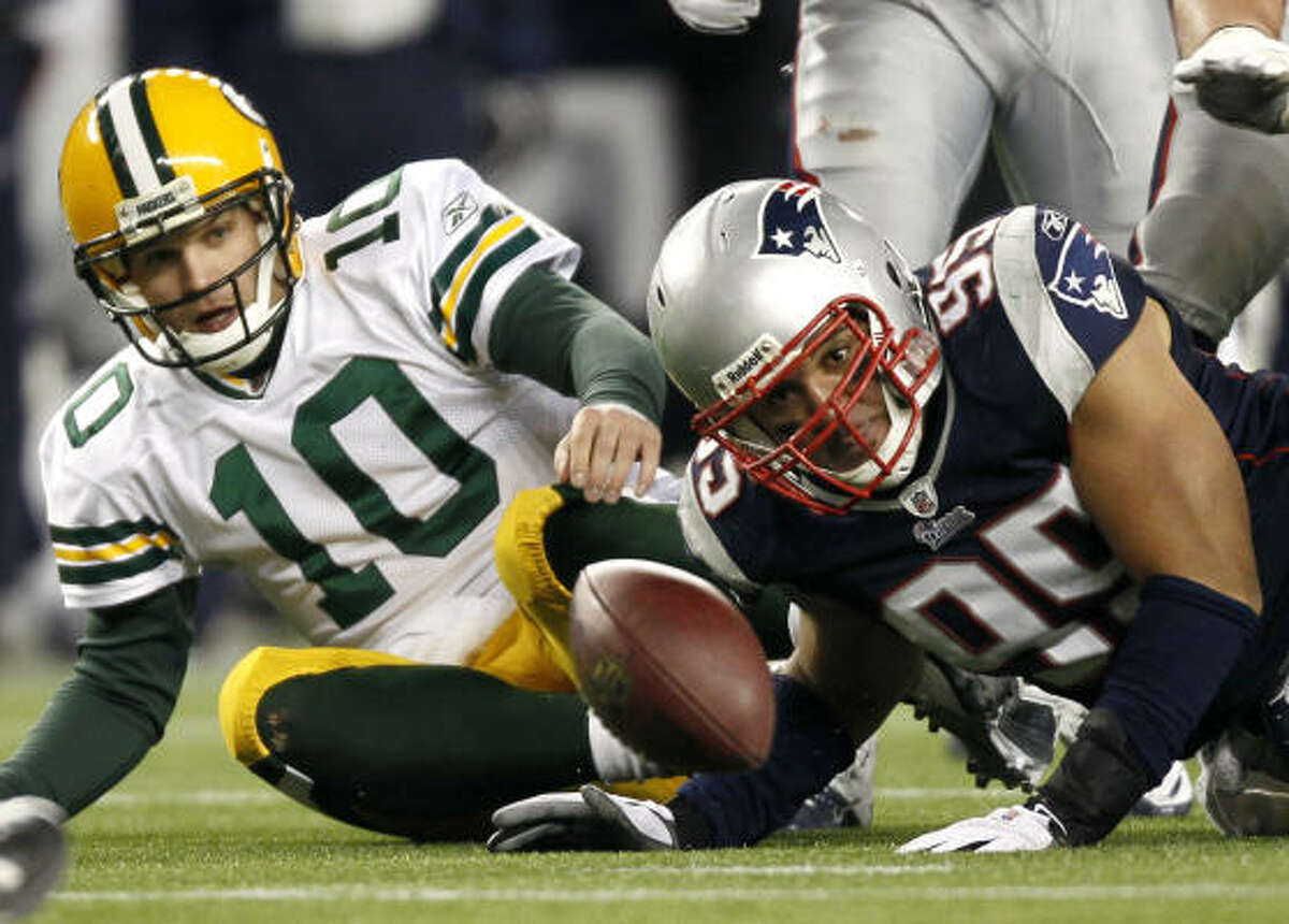 Dec. 19: Patriots 31, Packers 27 Patriots linebacker Tully Banta-Cain and Packers quarterback Matt Flynn (10) eye a fumble after Banta-Cain sacked Flynn on the final play of the game.