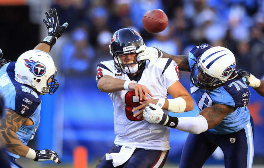 Dec. 19: Titans 31, Texans 17 Texans quarterback Matt Schaub (8) is hit by Titans defensive end Jacob Ford as he releases the ball for an incomplete pass during the fourth quarter. Schaub was roughed up repeatedly in Sunday's loss, being sacked four times. Photo: Brett Coomer, Chronicle