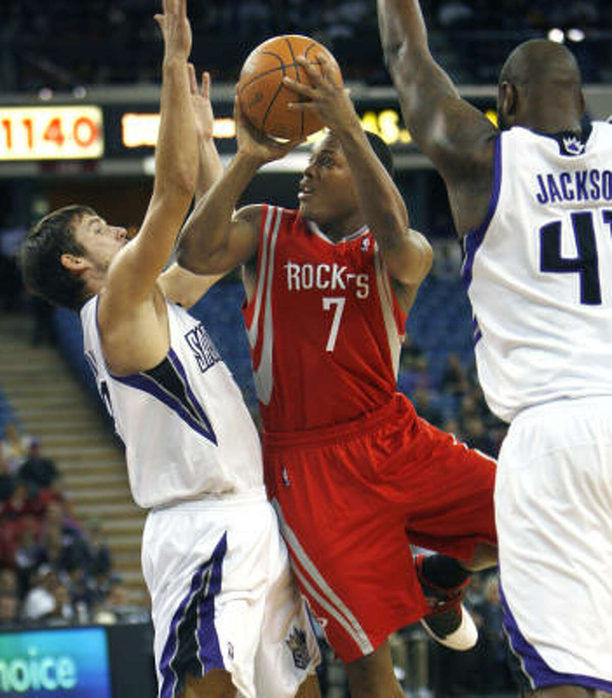 Rockets guard Kyle Lowry puts up a shot against Kings guard Beno Udrih, left, during the first half on Sunday night.