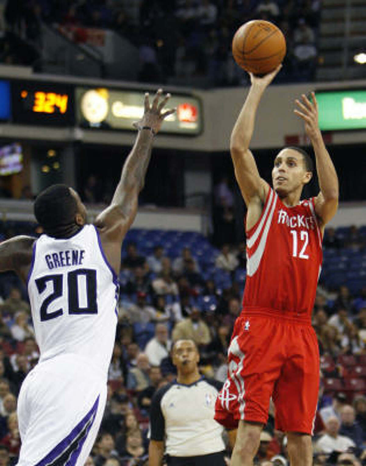 Rockets guard Kevin Martin, right, shoots over Kings forward Donte Greene during the first half.