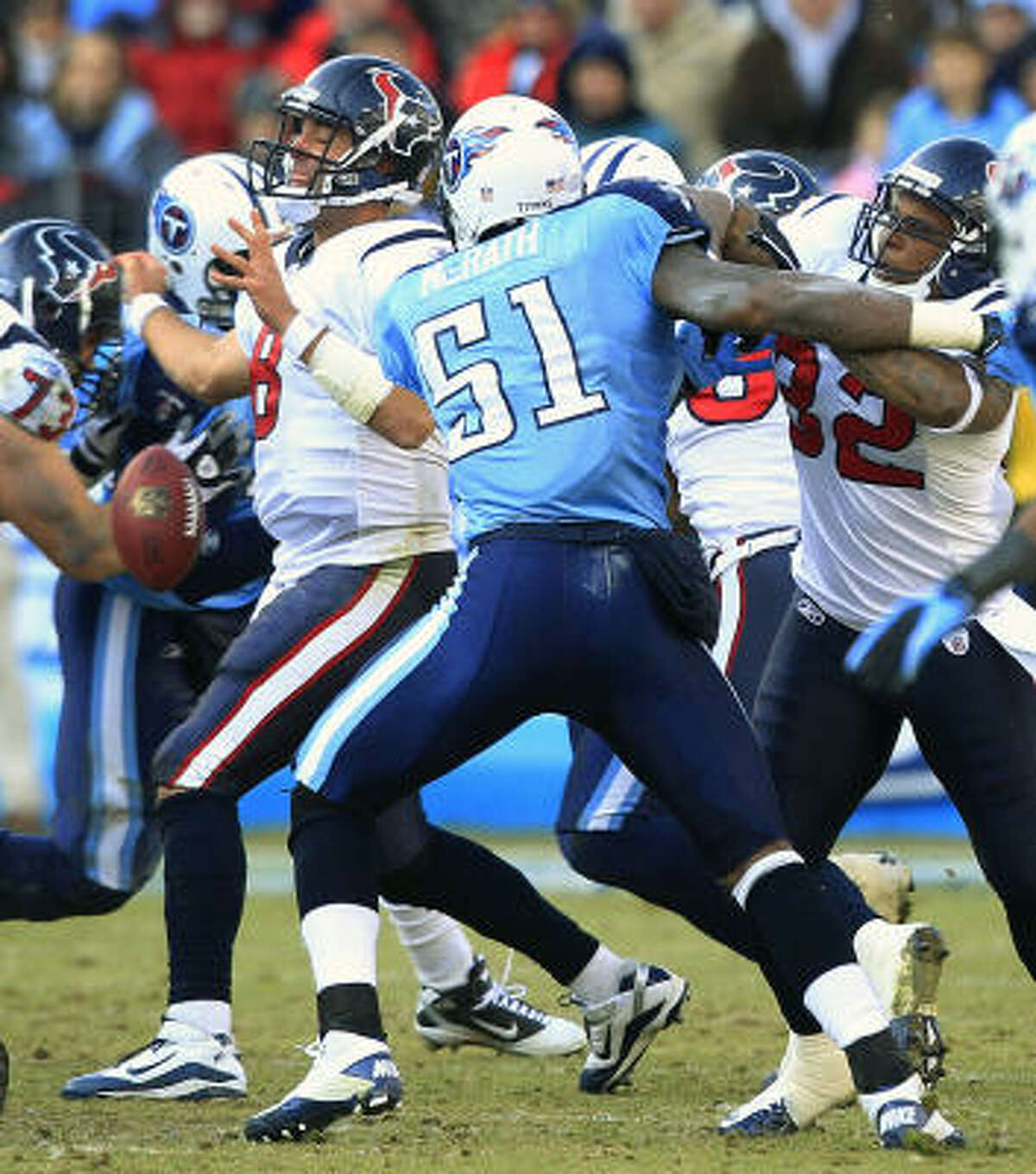 Texans quarterback Matt Schaub (8) fumbles after having the ball knocked out of his hand by Titans defensive end Jason Babin (obscured) and being pressured by linebacker Gerald McRath (51) during the fourth quarter.