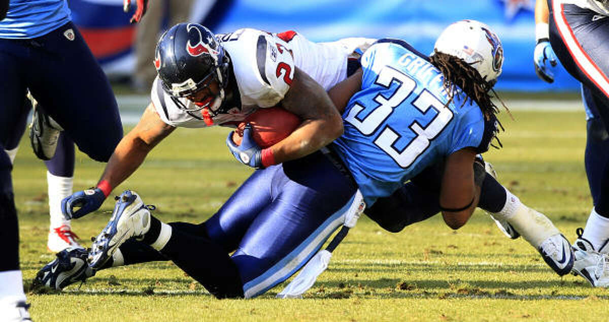 Texans running back Arian Foster (23) is stopped at the line of scrimmage by Titans safety Michael Griffin (33) during the fourth quarter.