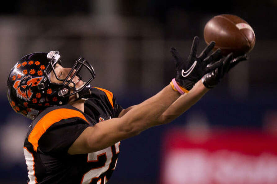 Aledo receiver Michael Mann (23) hauls in a pass during the second half.