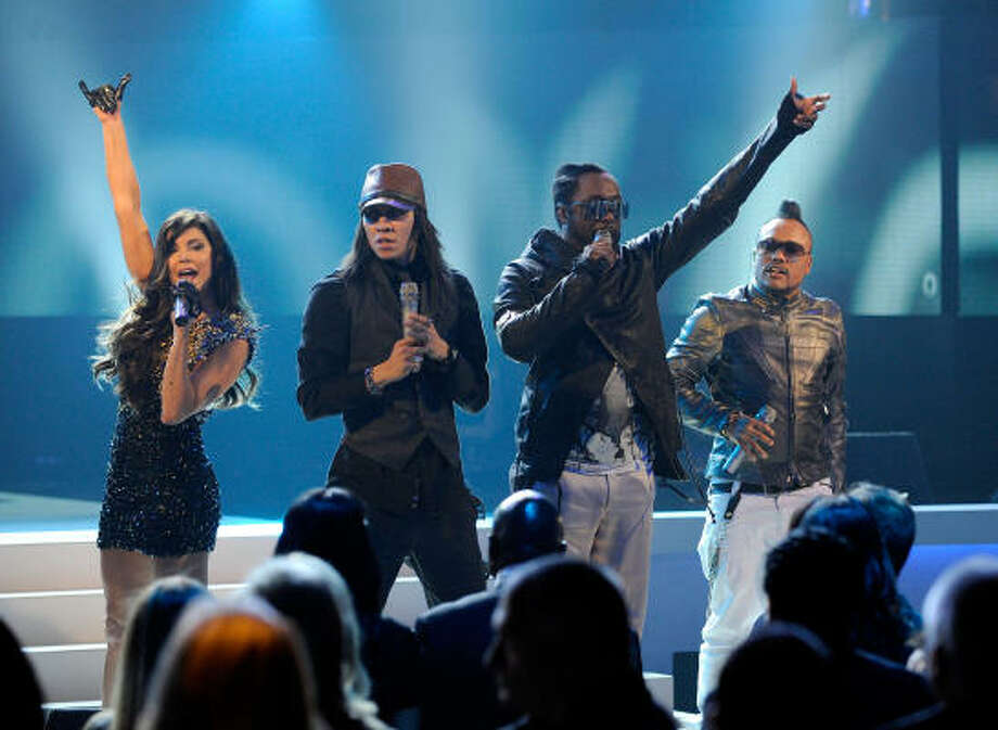 Singers Fergie, from left, Taboo, will.i.am and apl.de.ap of the Black Eyed Peas perform onstage in Los Angeles, California. Photo: Kevork Djansezian, Getty Images