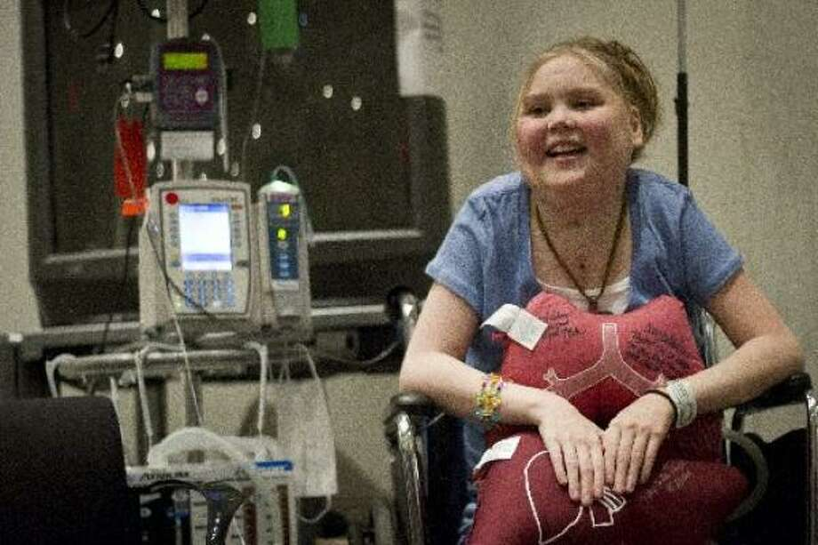 Taylor Sherrouse, 16, clutches a lung and liver pillow she was given after a 13-hour triple-organ transplant that replaced her heart, lungs and liver which were severely damaged by cystic fibrosis. Sherrouse is one of only three pediatric patients in the U.S. this decade to have received the rare triple-organ transplant and it was Texas Children's Hospital's first. Photo: Michael Paulsen/Houston Chronicle