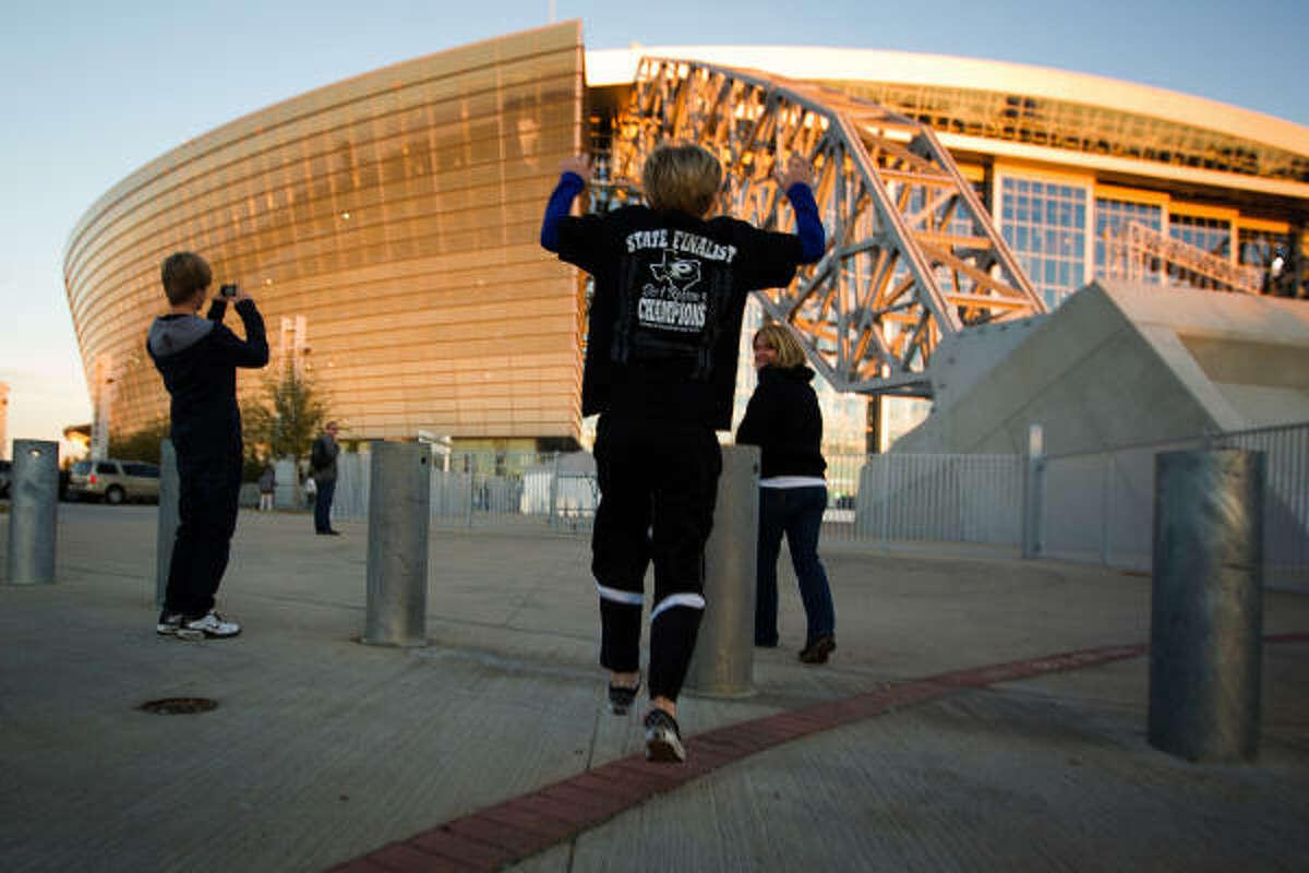 Pearland fan Jacob Keller, 10, runs toward Cowboys Stadium as he arrives with his family.