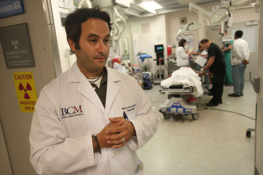 Dr. Mark Escott, an emergency room doctor at Ben Taub Hospital, says patients often wrongly believe that prescription medications are less dangerous than illegal drugs. Photo: Mayra Beltran, Chronicle