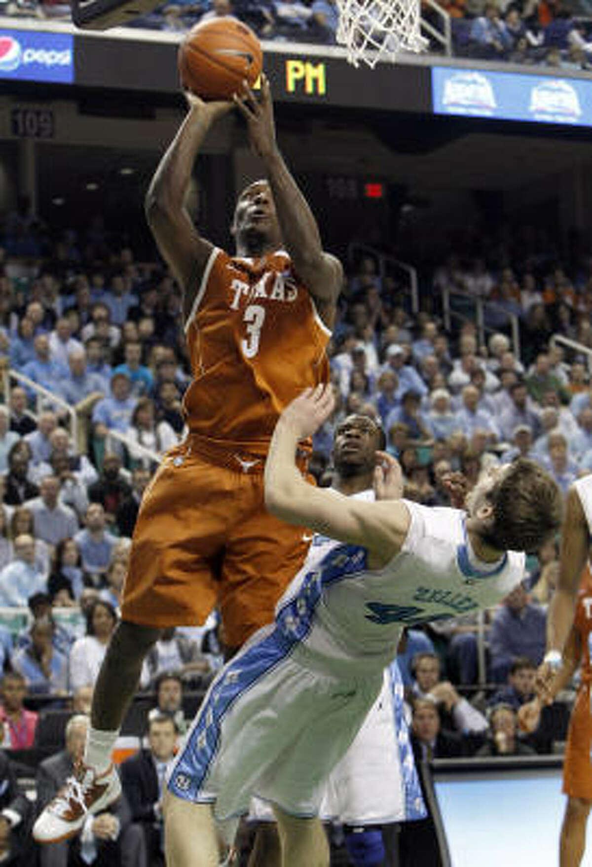 Texas' Jordan Hamilton shoots over North Carolina's Tyler Zeller during the first half.