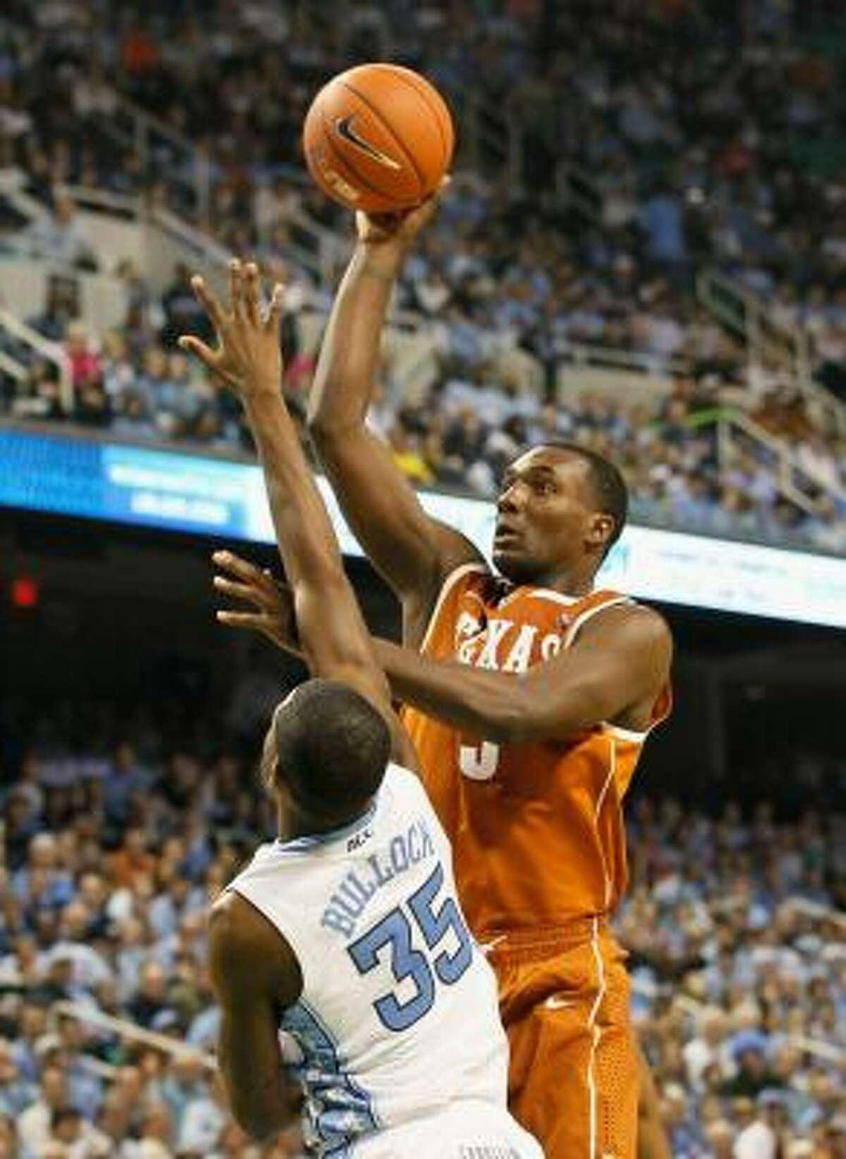 Texas' Jordan Hamilton shoots over North Carolina's Reggie Bullock.