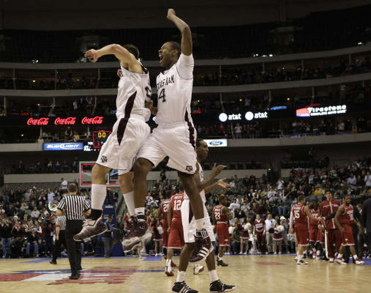 Texas A&M 71, Arkansas 62 (OT) Texas A&M's Nathan Walkup, left, and Keith Davis celebrate following their 71-62 overtime win.