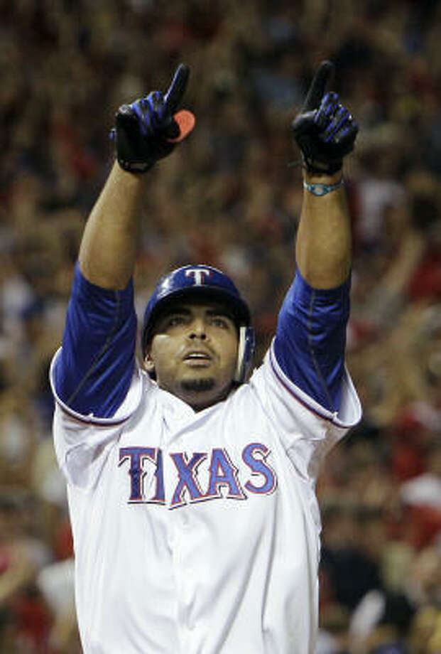 The Rangers' Nelson Cruz celebrates after a two-run home run off Yankees relief pitcher David Robertson in the fifth inning of Game 6 on Friday night. Photo: Chris O'Meara, AP
