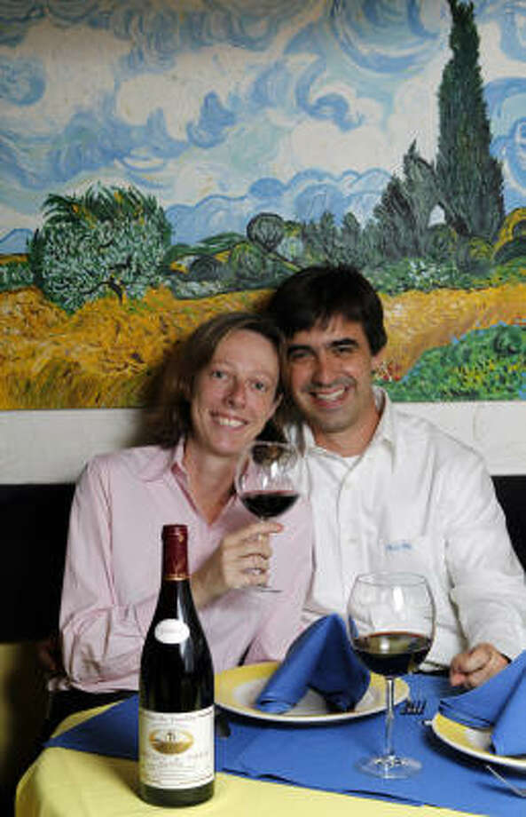 Genevieve and Jean-Philippe Guy, owners of  Bistro Provence, will honor the tradition of tasting the most recent vintage of beaujolais on the morning of its annual release. Photo: Melissa Phillip :, Chronicle