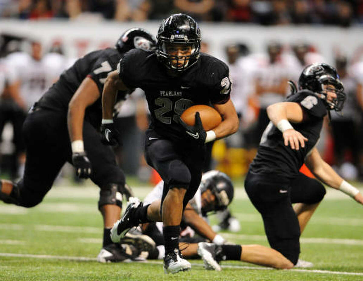 Pearland running back Dustin Garrison breaks into the secondary.