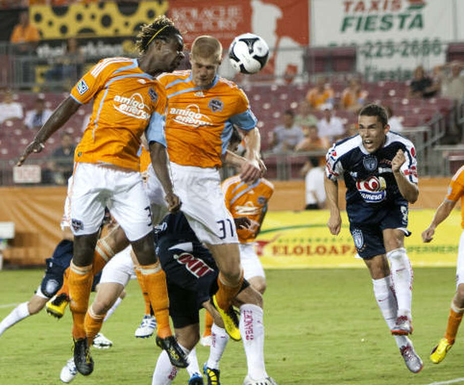 The Dynamo's unprotected players, such as Joseph Ngwenya, left, were not taken by Portland or Vancouver. Photo: Brett Coomer, Chronicle