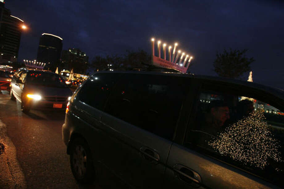 About 30 cars in Houston, and more than 50 more throughout the state, will carry menorahs on their roofs, according to Yossi Zaklikofsky of the Chabad Pearland Jewish Center. Photo: CHRONICLE FILE