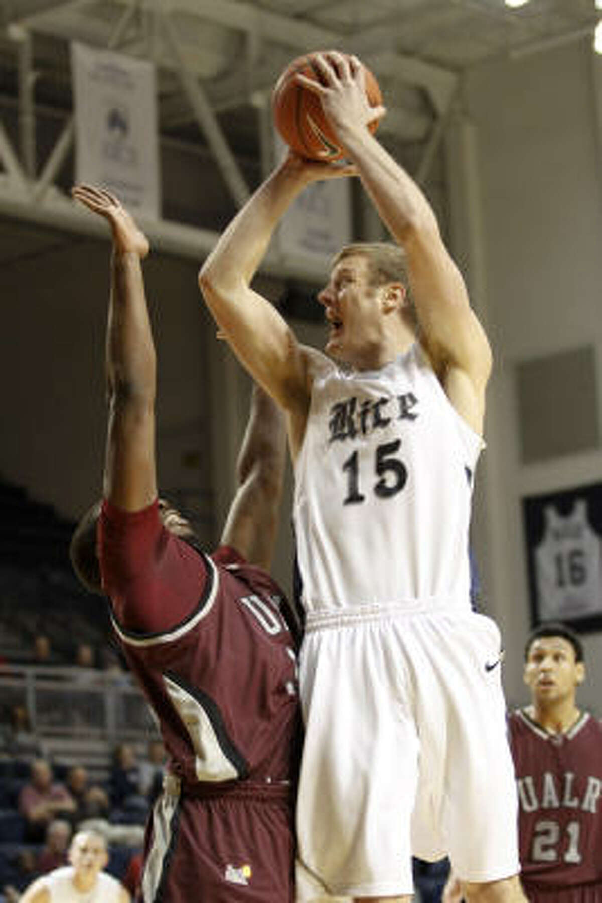Rice center Trey Stanton shoots over an Arkansas-Little Rock defender.