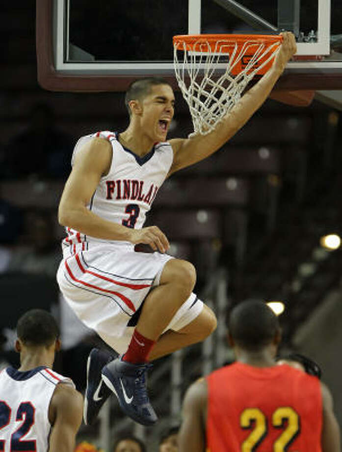 Findlay Prep's Nick Johnson throws down a vicious dunk for the game's first points. He finished with a game-high 24. Photo: Nick De La Torre, Chronicle