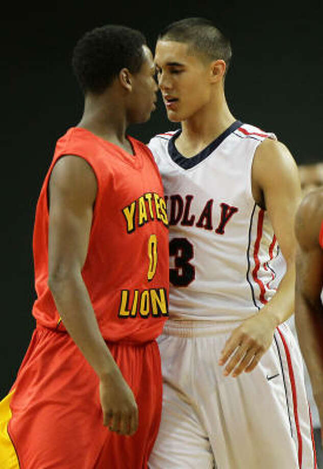 Yates' DJ Lewis, left, has a few choice words for Findlay Prep's Nick Johnson in the second quarter. Photo: Nick De La Torre, Chronicle