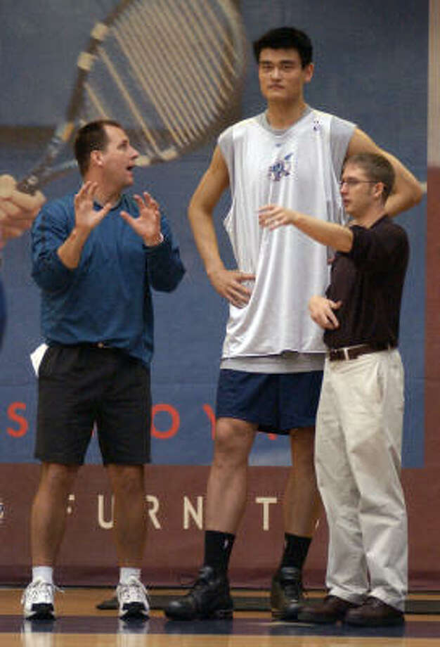 Making the transitionYao gets directions from assistant coach Jim Boylen, left, and interpreter Colin Pine during his first workout with the Rockets in 2002. Photo: Karl Stolleis, Chronicle