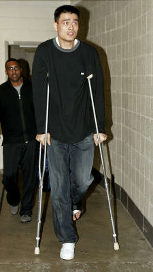 Season-ending injury at season's endWith only four games remaining in the 2005-06 season, Yao suffered a broken bone in his left foot against the Utah Jazz. Photo: DOUGLAS C. PIZAC, AP