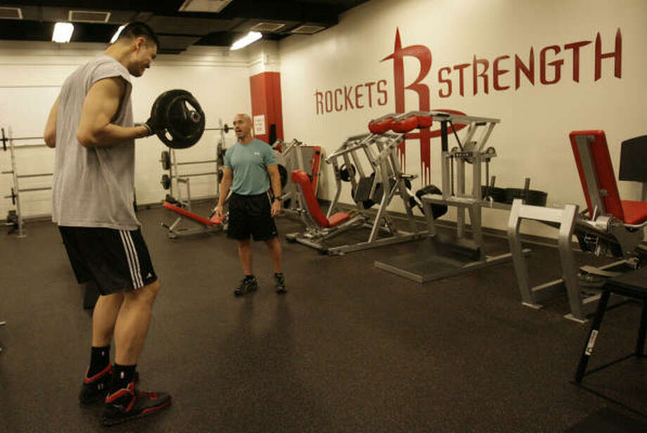 Road to recoveryWhile the Rockets are playing the Jazz in a 2008 first-round playoff series, Yao works with a personal trainer in his recovery from a stress fracture in his left foot. Photo: Julio Cortez, Chronicle