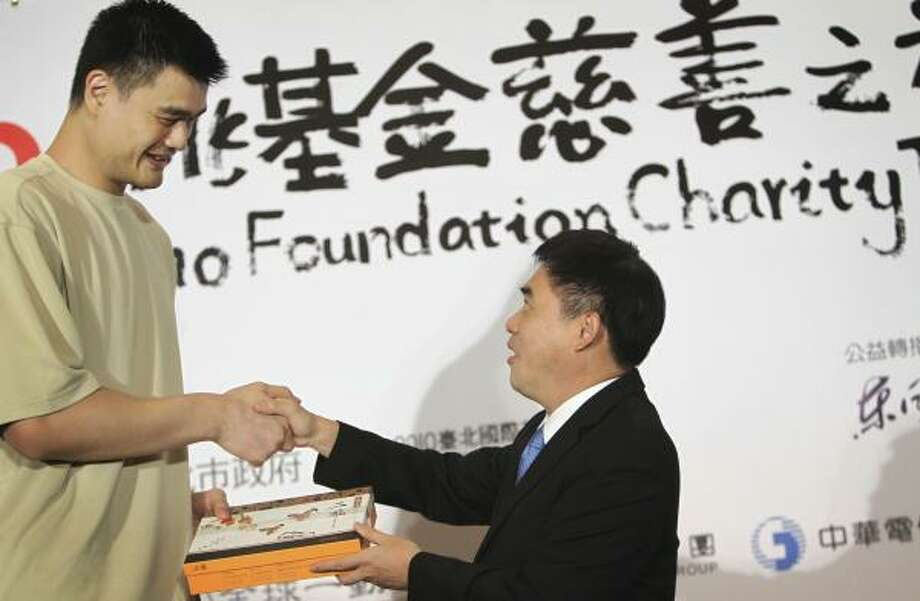 Foreboding promiseYao attends an event for his foundation in Taiwan on July 27, 2010 — the day he said he'd leave basketball after the following season if his foot didn't fully heal. Photo: Wally Santana, AP