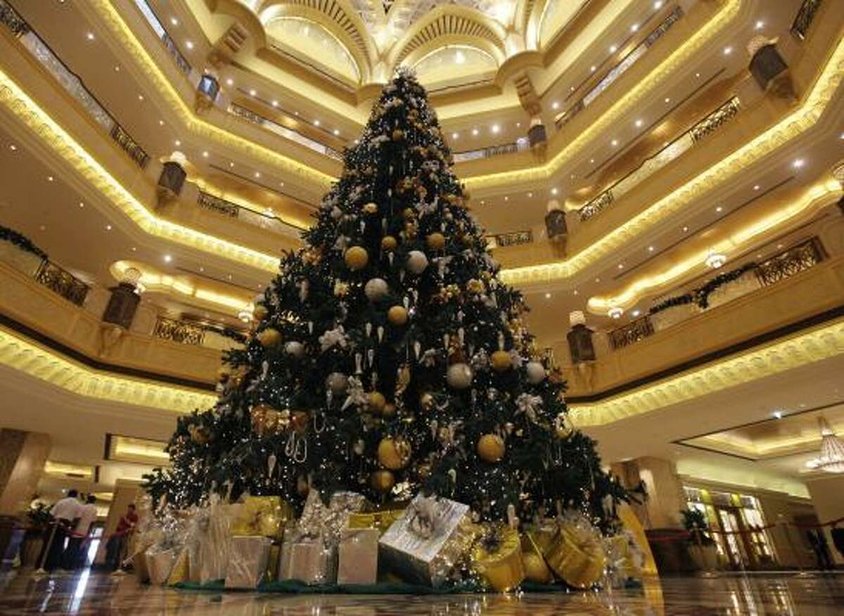 Emirates Palace hotel, in Abu Dhabi, United Arab Emirates. The $11 million tree is a 43-foot faux fir with golden ornaments covered in gemstones.