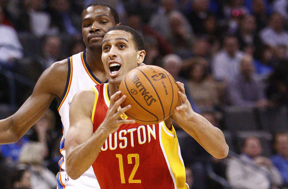 Dec. 15: Thunder 117, Rockets 105 Rockets guard Kevin Martin drives to the basket in front of Thunder forward Kevin Durant during Wednesday night's game in Oklahoma City. Martin led the Rockets with 22 points on 7-of-14 shooting.