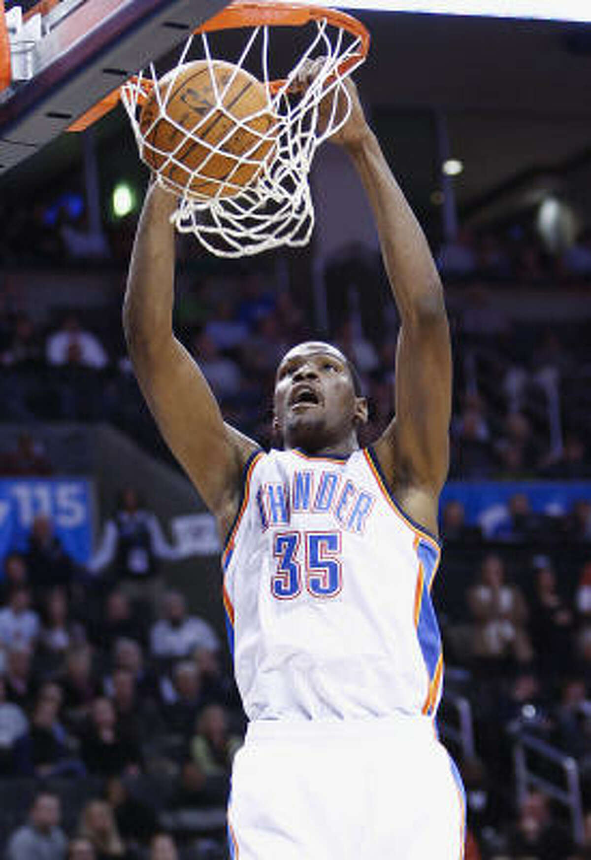 Thunder forward Kevin Durant slams home a dunk. He finished with a game-high 32 points.