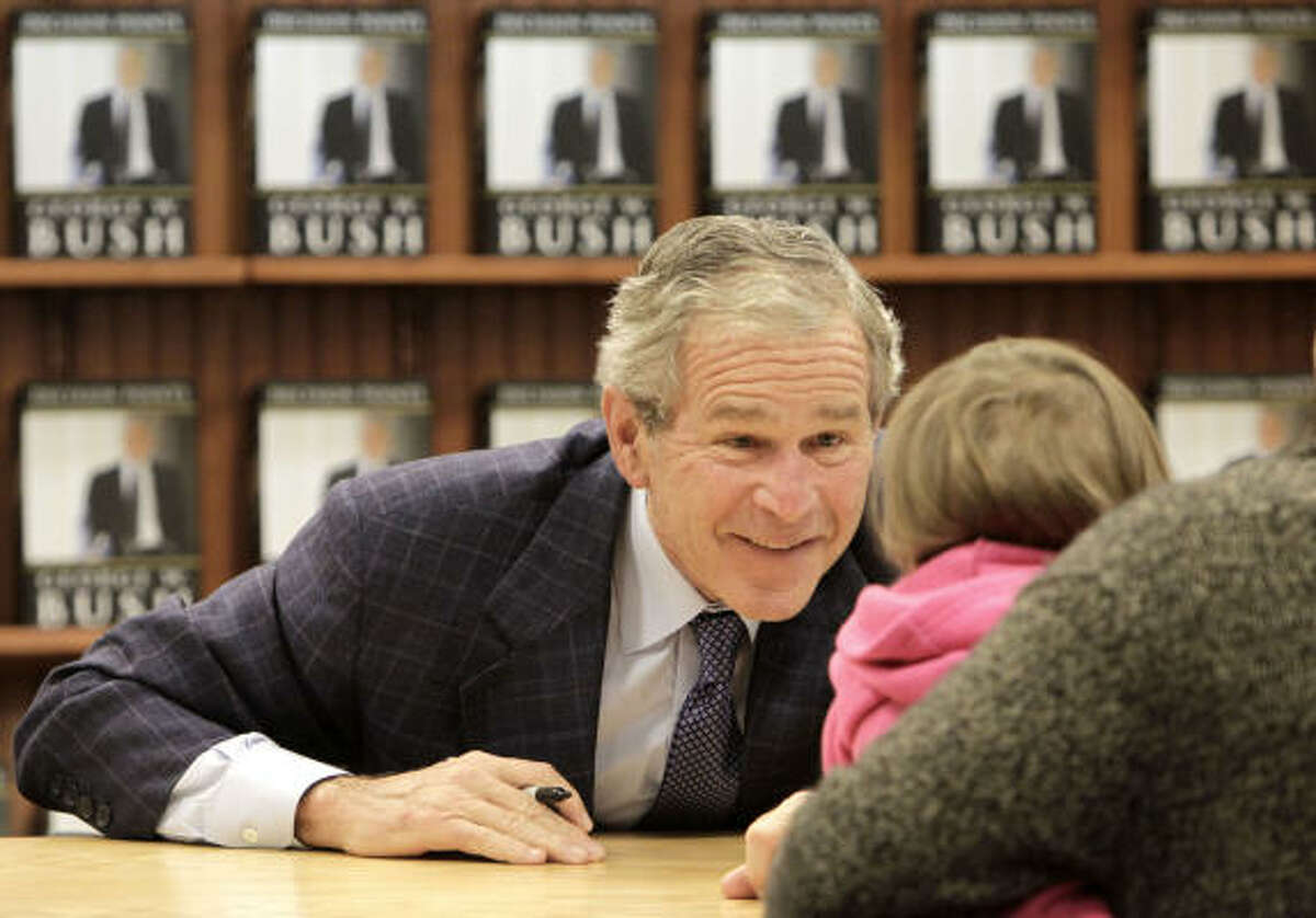 Sasha Poteat, 3, gets an up close and personal look at former President George W. Bush during a book signing event at the Barnes & Noble bookstore in the River Oaks shopping center on Wednesday, Nov. 17, 2010, in Houston. Bush was in town to autograph his newly released memoir Decision Points.