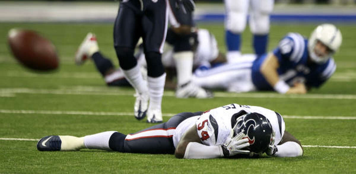 Houston Texans linebacker Zac Diles (54) reacts after missing a chance at an interception of a pass by Indianapolis Colts quarterback Peyton Manning (18) during the third quarter of an NFL football game at the Lucas Oil Stadium Monday, Nov. 1, 2010, Indianapolis. The Colts beat the Texans 30-17.